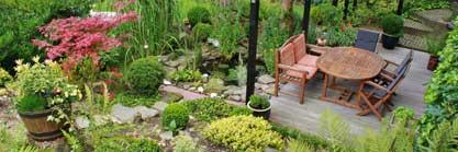 Das Holzgartenhaus  mit Terrassenüberdachung: Bester Schutz in hoher Qualität